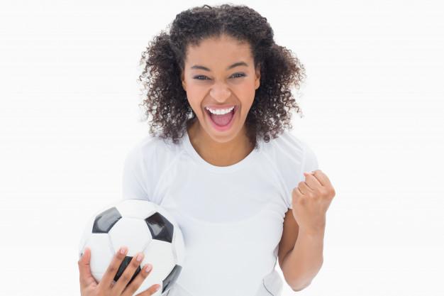 pretty-girl-holding-football-and-cheering-at-camera_13339-203177